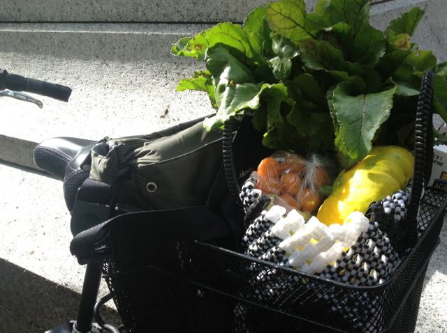 picking up produce packs by bike