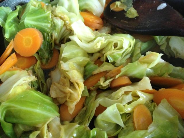Summer cabbage with carrots and onions lightly stir fried with a little soy sauce.