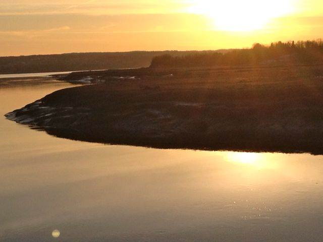 Evening photo of Cogmagun River, at the end of the winter when the ice has cleared away.  Sigh...