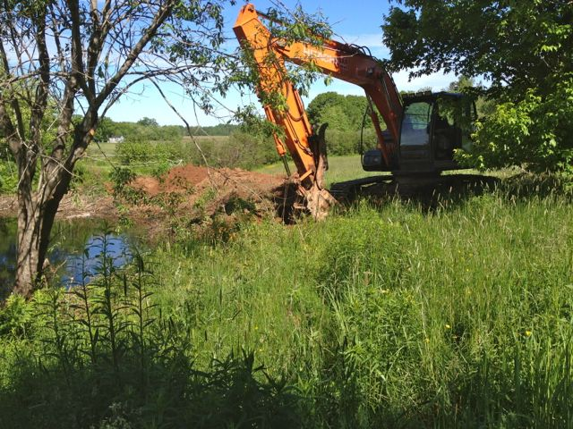 Building the pond overflow spillway