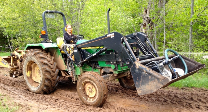 With a little encouragement, Victoria finally tried driving the tractor