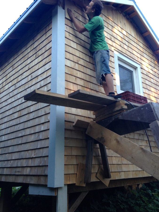 Kevin has started the job of shingling the cabins.