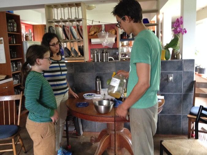 Sam, Karen, and Bernard discussing Kombucha